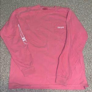 A pink long sleeve field hockey shirt